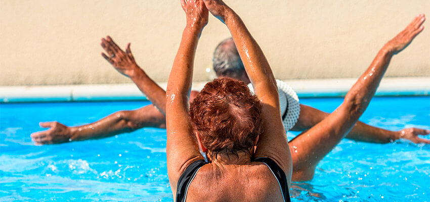 seniors working out in a pool